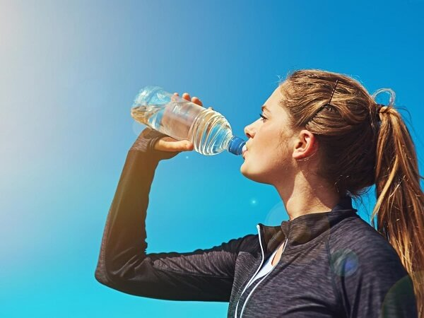 Drinking water from a plastic bottle